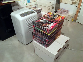 Stacks of wet recent Marvel Mutant books and 1960s and '70s Archie And Me being dehumidified. (Is that actually a word?)