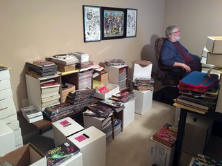 KC surrounded by comics